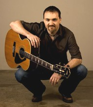Dave Milliken with his Yamaha acoustic guitar